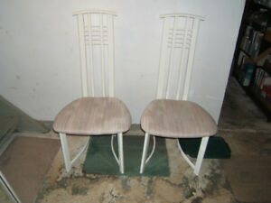 Nice pair of modern ladder back contemporary chairs.
