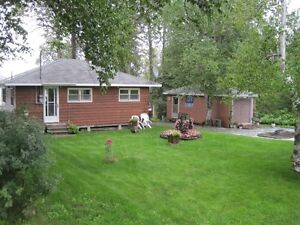 Lakefront Fully-furnished Cottage with Double Lot & Boat