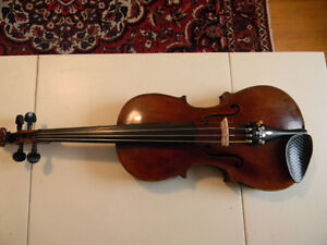 A vintage 4/4 Stainer violin, and a free 1/2 size German violin