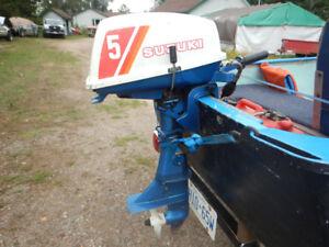 5 HP SUZUKI OUTBOARD MOTOR WITH TANK & HOSES $200 O.B.O.