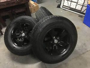 Ram 1500 Black painted stock wheels