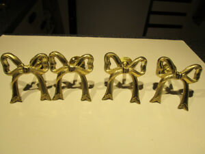 2 sets of 2pc brass bow design curtain tie backs.