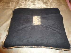 large black sit-upon floor pillow