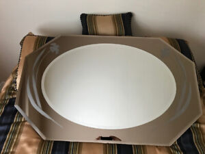 oval beveled edge mirror in beveled edge octagon w/floral design