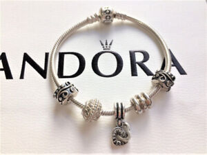 Authentic Pandora Bracele with 5 Pandora Charms