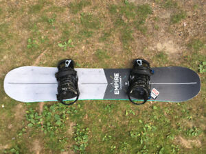 EMPIRE snowboard with boots and brand new helmet for sale