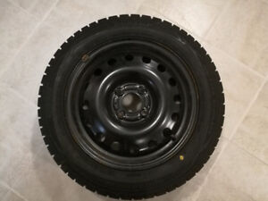 4 Dunlop Snow tires 185/60R15 84T with Rims