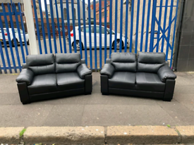 2 2 seater sofas in black leather £199-few marks hence price