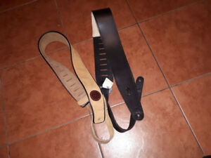 Two Levy leather guitar straps