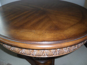 Large round side table, ornate detail