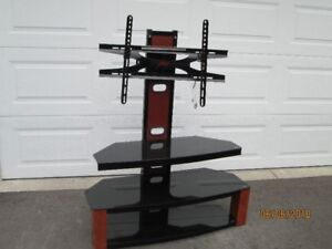 """TV stand for 55"""" TV.  3 glass shelves. Great shape"""