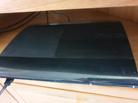 Super-slim PS3 (boxed), 2 controllers, several games