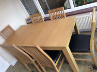 Wooden table and 6 matching chairs.