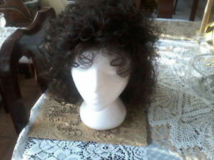 BRAND NEW IN THE BOX 12 INCH LONG CURLY WIG SIZE AVERAGE TAGS ON