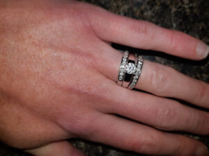 Engagement ring with wedding band and 1 year Anniversary band.