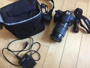 Appareil photo Canon T5 avec lentille Canon EF 28-135mm
