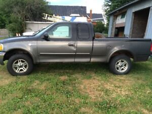 WANTED 2003 F150 EXTENDED CAB DRIVERS DOOR OR WHOLE TRUCK