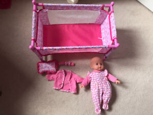 Baby doll and crib with some accessories