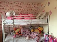 white bunk beds with 2 single matresses