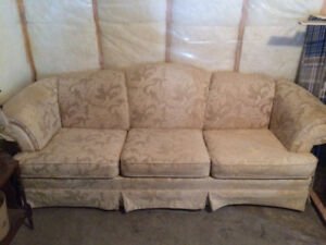 Two matching love seats and one medium size couch
