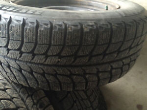 Michelin X-Ice 225-60-16 on Ford steel rims W/Hubcaps