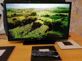 Sharp 32inc slim TV with new remote