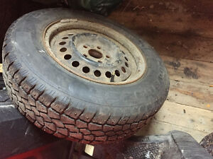 4 studded winter tires on rims St. John's Newfoundland image 1