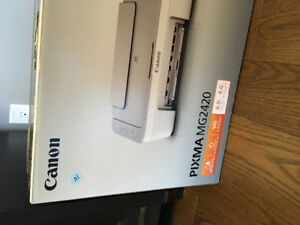 New canon printer never used with its ink Call 306 370-0946