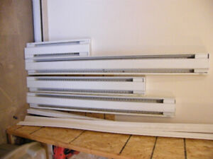 Used electric baseboard heaters and light fixture