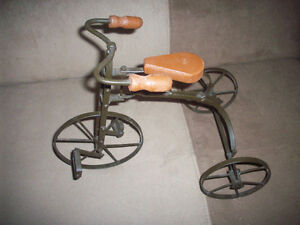 Antique/vintage? Wrought iron and wood tricycle for dolls.