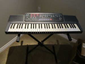 Casio CTK 500 electric keyboard with stand