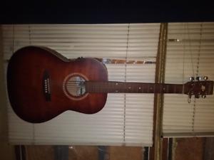 Parlor size cherry acoustic/electric.