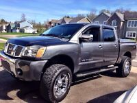 Lifted Nissan Titan in excellent condition Sale or Trade