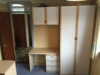 Fitted wardrobe and bridging units