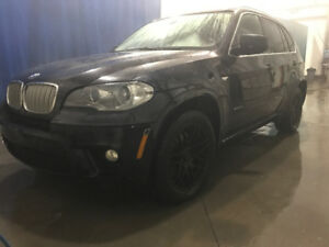 2013 BMW X5 50i All wheel drive with studed winters