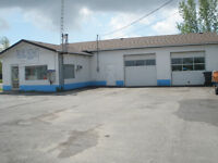 Large Garage with Office plus House on 1.2 acres of Land