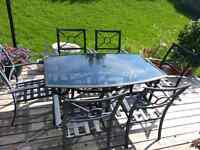 Cast aluminum glass top dining table.