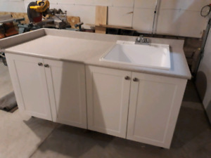 Laundry tub with cabinets and counter top
