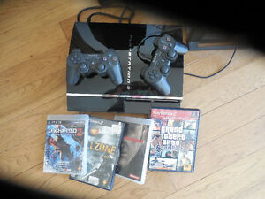 PS3 with four games for sale