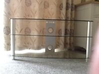 Clear glass and chrome TV unit