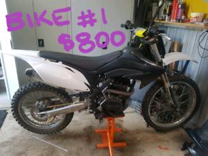 2 x different size dirt bikes