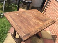 Antique extendable dining table