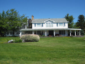 Executive Home in Shediac sitting on 2+ acres of waterfront!