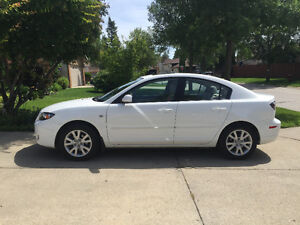 2009 Mazda3 5 SPEED MANUAL W/ WINTER TIRES ON RIMS, SAFETIED