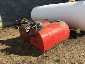 Two 100 gallon slip tanks with pumps for sale.