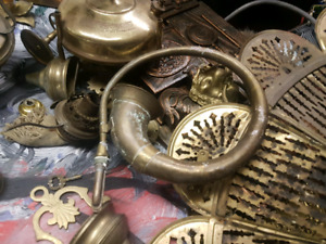 Old brass oil lamps and parts and a brass steampunk horn art