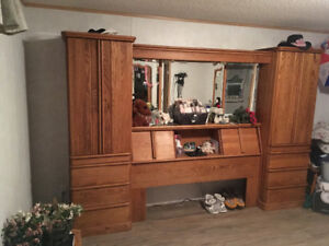 Queen headboard and storage center with pillars