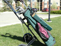 Set of spalding clubs with golf bag and pull cart