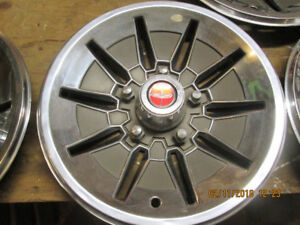5 older ford full disc hubcaps