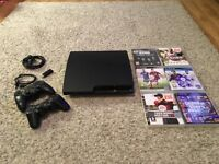 PS3 Slim with 2 controllers and 6 games